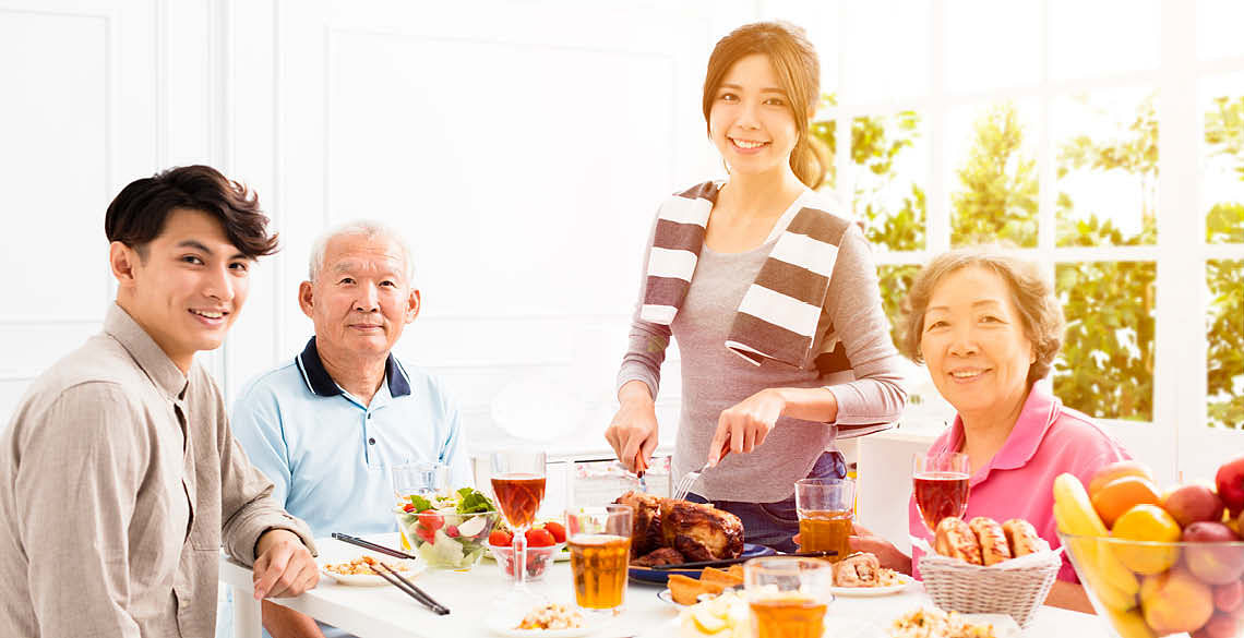 An Asian family having a meal in the day for Father's Day