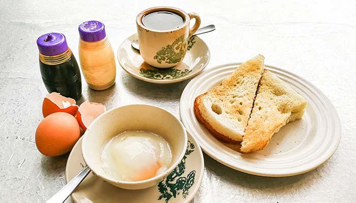 typical singapore coffee shop breakfast kaya toast coffee soft-boiled eggs