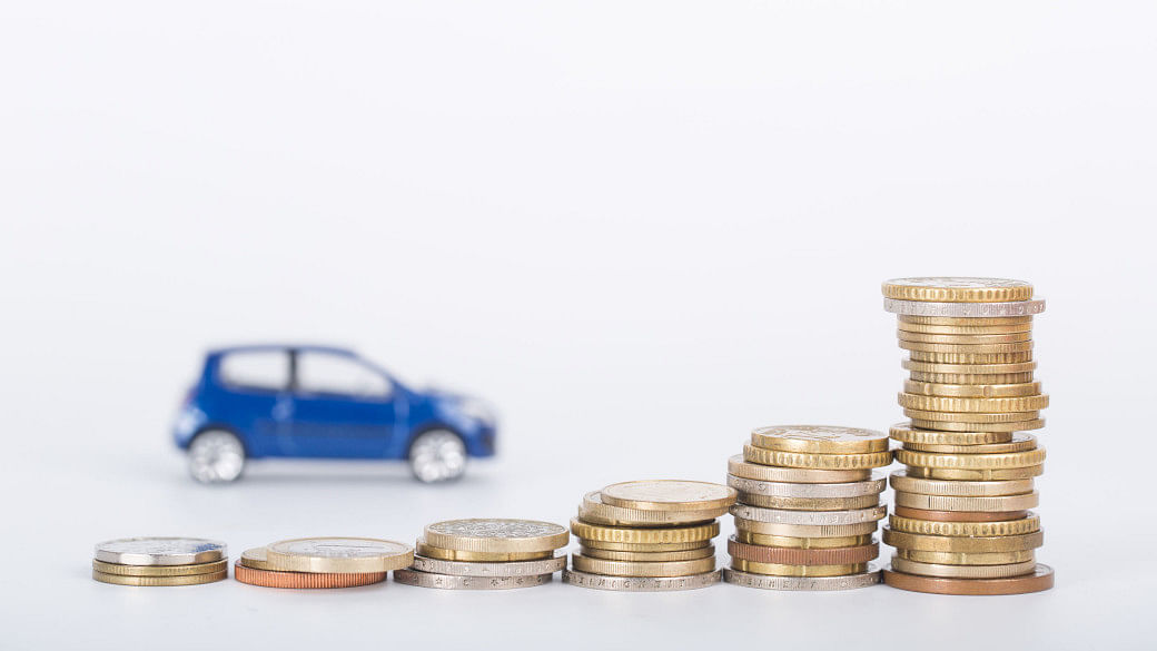 Car finance money stack with white background.