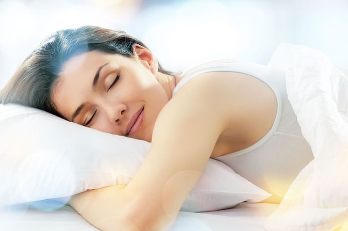 woman happy smiling sleeping bed