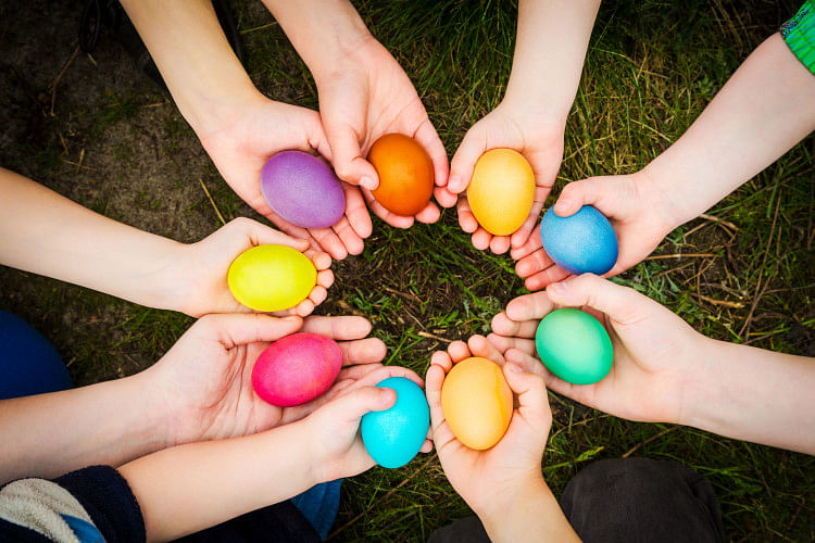 colourful Easter eggs in hands