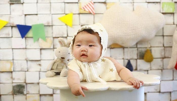cute baby sitting in a high chair