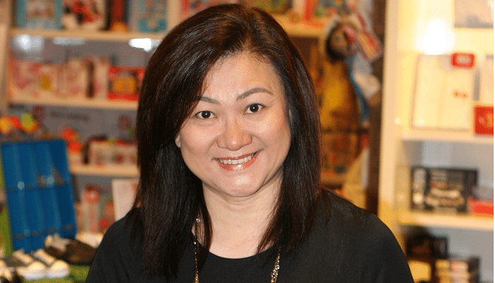 Sharon Wong takes a photo in a Motherworks outlet