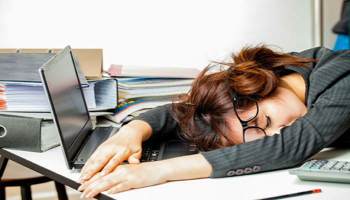 stressed woman lying on desk