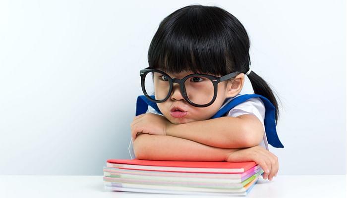 cute preschooler girl in oversized round specs