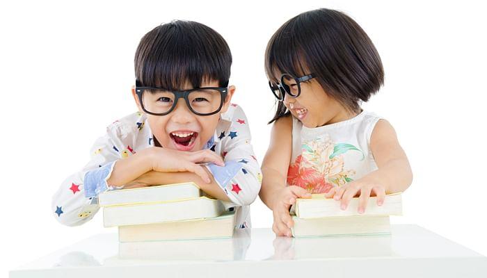 two children in oversized specs