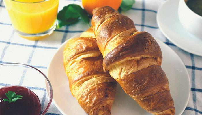 French women eat breakfast croissant