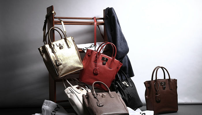luxury bags untidily stacked
