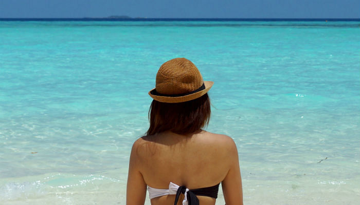 How To Protect Your Hair From Sun Damage-Wear a hat