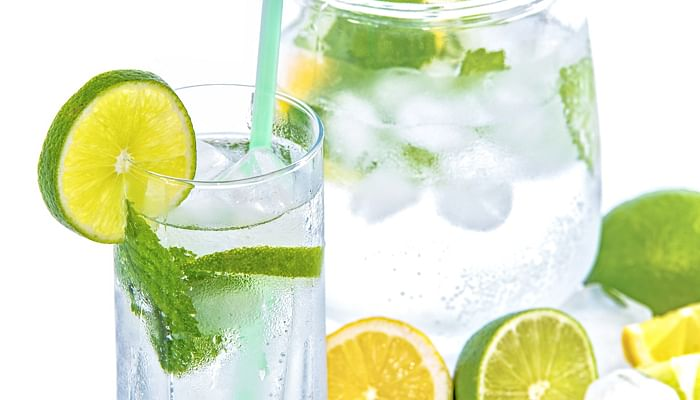 One way to increase daily intake of lemon and lime juices is to squeeze them into your jar of water. (Photo: Pixabay)