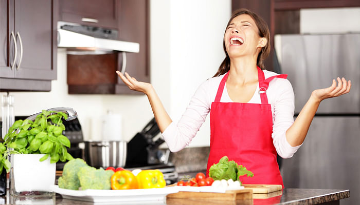 15892022-funny-cooking-image-of-woman-crying-and-screaming-in-kitchen-giving-up-making-food-after-unsuccessfu
