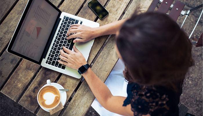 woman typing on laptop social media