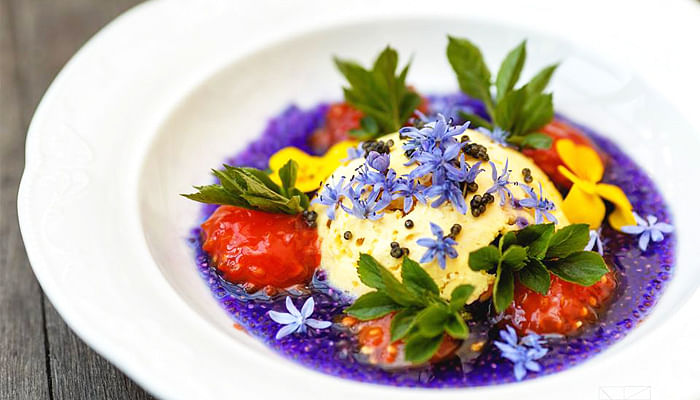 Salt souffle with white chocolate and chia seeds marinated in blue cabbage