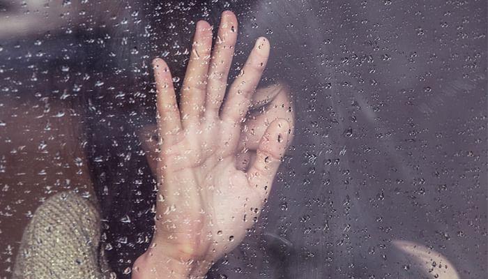 sad girl at the window on a rainy day