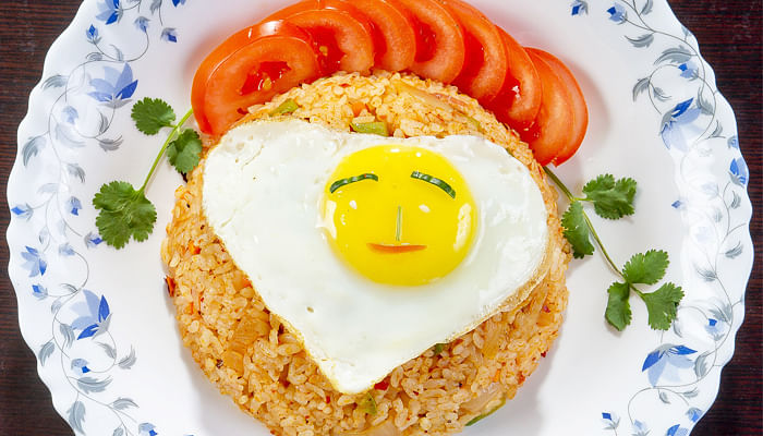 plate of fried rice with a smiley egg
