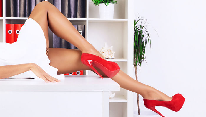 legs of sexy businesswoman lying on work table in the office