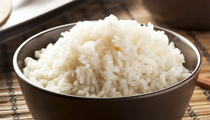 bowl of white rice with chopsticks