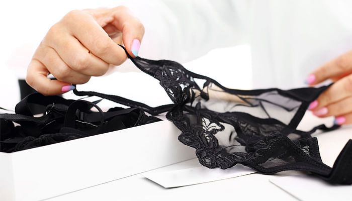 sensual-lingerie-beautiful-gift-for-a-woman-hands-women-packing-lacy-underwear-in-a-box