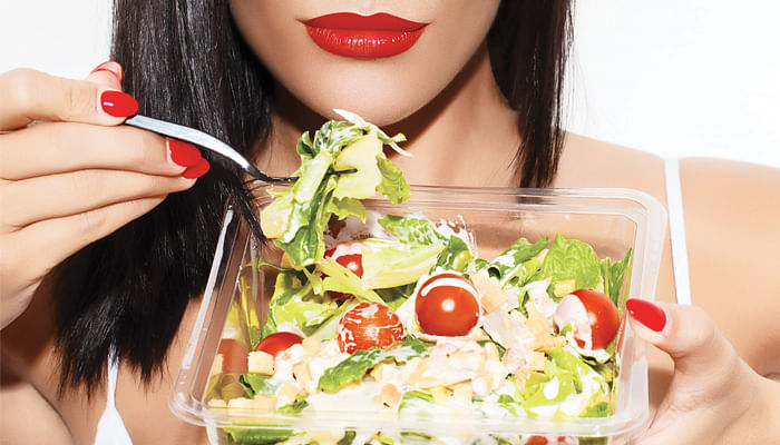 sexy woman eating a salad