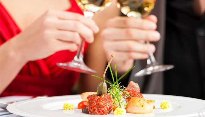 11529246-couple-for-romantic-dinner-or-lunch-in-a-gourmet-restaurant-drinking-wine-and-eating