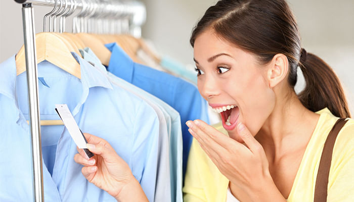 13506291-shopper-woman-surprised-over-sale-price-happy-asian-shopping-woman-surprised-over-rebate-prices-look-Stock-Photo