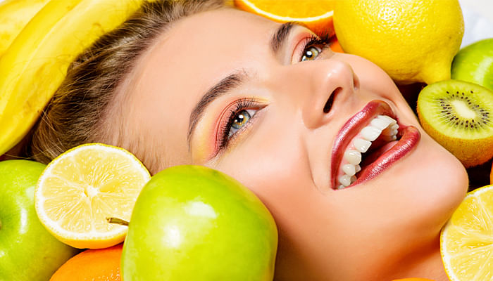 woman-good-skin-beauty-with-citrus-fruits