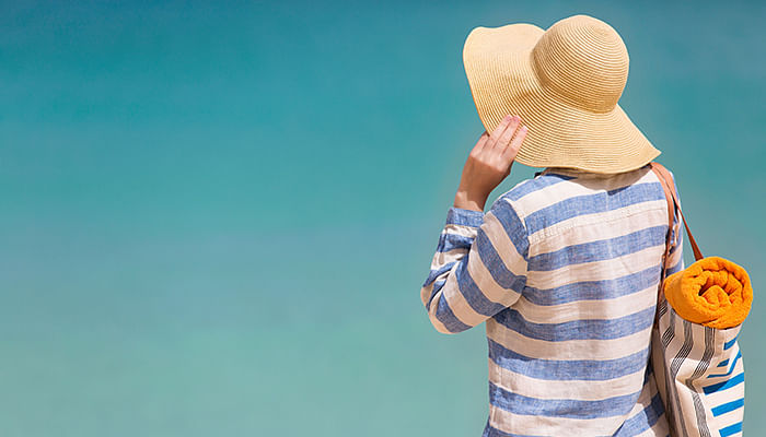 woman-at-the-beach-hiding-from-the-sun2