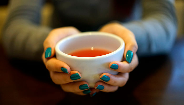 woman-with-nice-manicure-enjoying-a-cup-of-tea-tea_resized