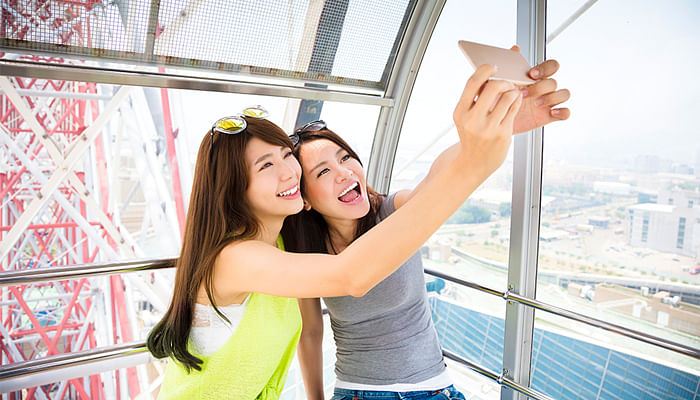 women-taking-selfie-on-a-cable-car-ride