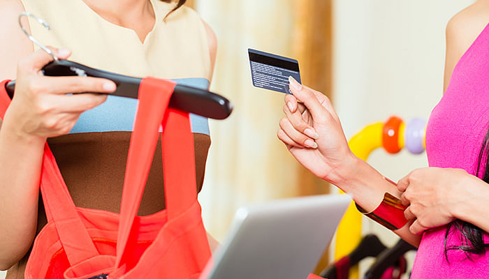 woman-shopping-paying-with-credit-card