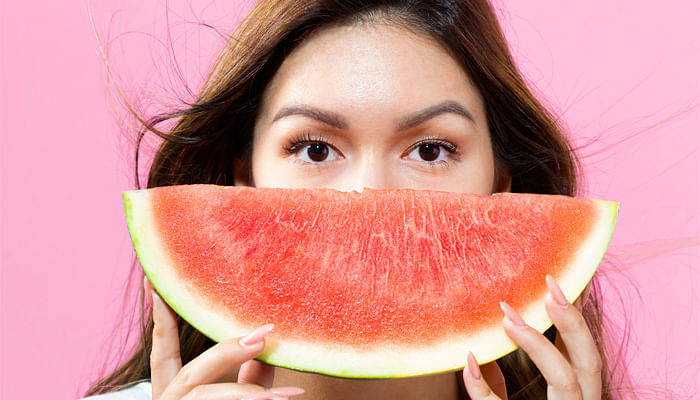 happy-woman-eating-watermelon