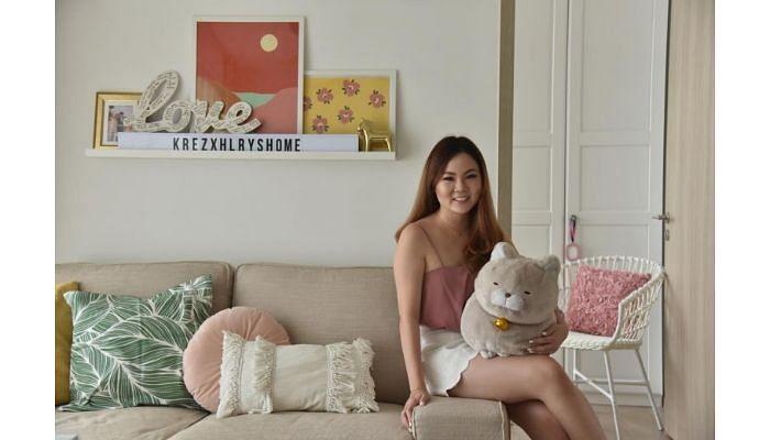 woman smiling on white sofar