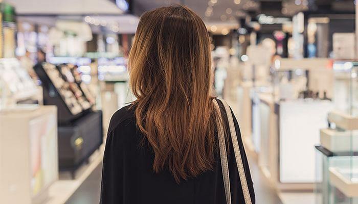 woman-shopping-in-cosmetics-beauty-counter