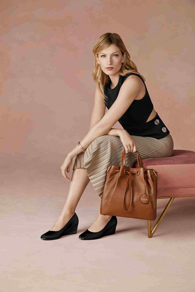 Cole Haan model shot with Grand Ambition bag and shoe
